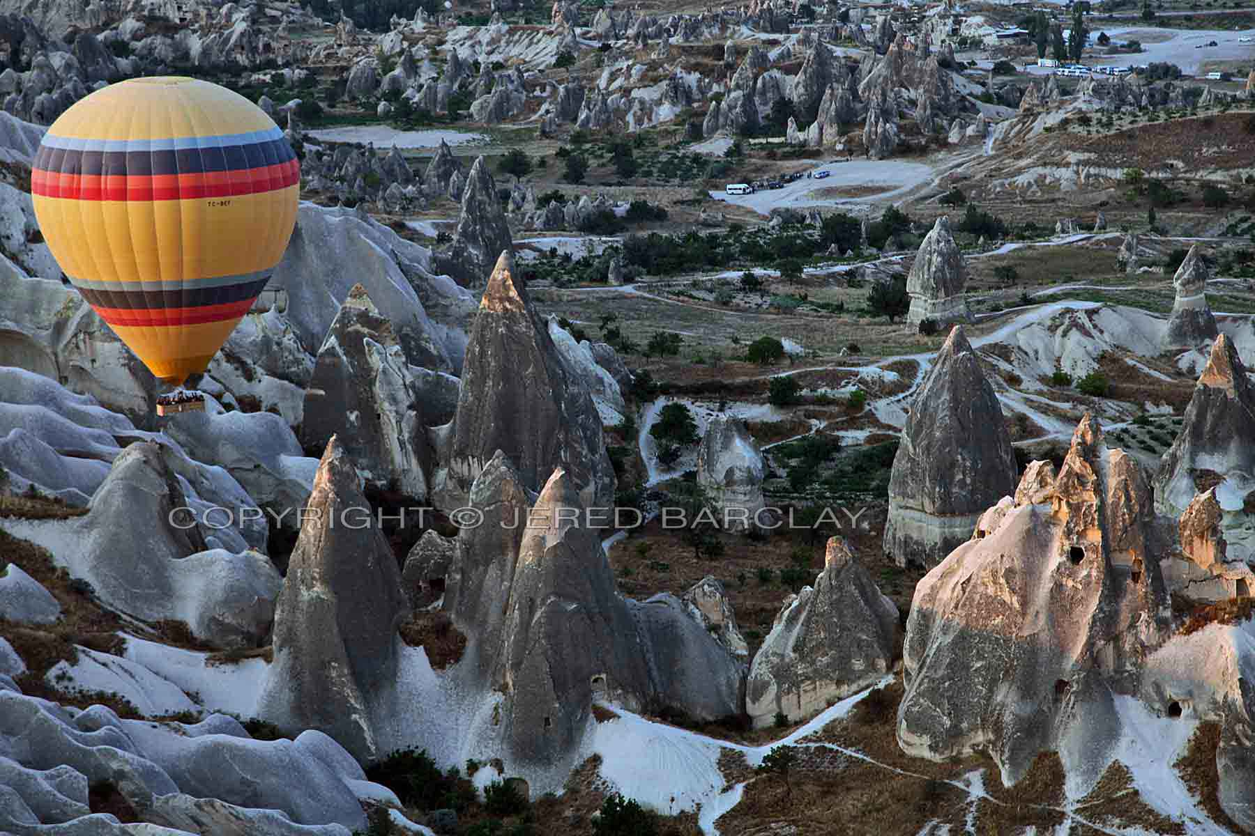 Hot air balloon over Cappadocia at dawn.